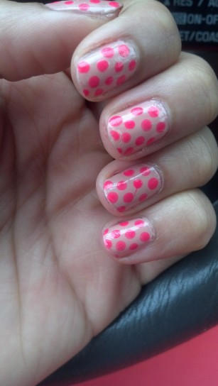 nude and neon pink polka dots mani