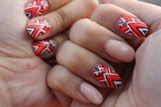 White Orange and Black nails